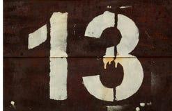 Nr. 13 in der Schablone auf Metallwand lizenzfreie stockfotos