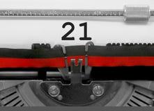 Nr. 21 durch die alte Schreibmaschine auf Weißbuch Stockbild