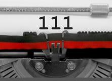Nr. 111 durch die alte Schreibmaschine auf Weißbuch Stockbild