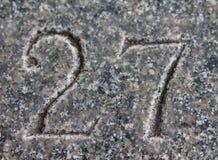 Nr. 27 geschnitzt im Stein Stockfotos