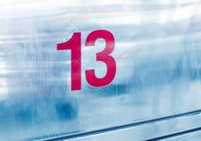 Nr 13 op metaalachtergrond Stock Afbeelding