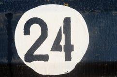 Nr. zwanzig vier auf der metall Platte Lizenzfreie Stockfotos