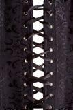 Nära övre svartkorsett Royaltyfri Foto
