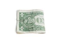 Närbild av pappers- dollar i gem över vit bakgrund Fotografering för Bildbyråer