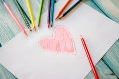 Närbild av röd målad hjärta Arkivfoto