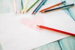 Närbild av röd målad hjärta Arkivfoton