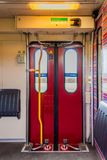 NS train inside entrance to the train car first class. Nederlandse Spoorwegen Dutch Railways or NS is the principal passenger railway operator in the Netherlands stock photos