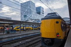 NS train Utrecht central station with Stadskantoor Royalty Free Stock Photography