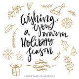 Önska dig en varm semesterperiod kortjul som greeting Arkivbild