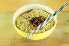 Nstant noodles in yellow dish Royalty Free Stock Photography