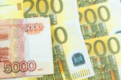 Euro,ruble banknotes. Nternational currencies background. Money from different countries: euros, rubles stock photo