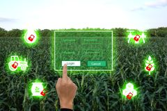 Nternet of thingsagriculture concept,smart farming,industrial agriculture.Farmer use the finger unlock the key and access to the stock photography