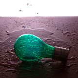 Light bulb in the water royalty free stock photography