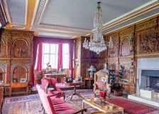 The Red Drawing Room, Burton Agnes Hall, Yorkshire, England. The Red Drawing Room features the original Elizabethan wood panelling which was gilded in the 1800s stock image