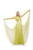 Nätt flicka i den eleganta gröna klänningen som isoleras på Royaltyfria Bilder