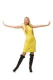 Nätt ganska flicka i den gula klänningen som isoleras på vit Royaltyfri Fotografi