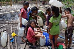 Children look for clean water in the dry season