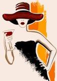 Nätt kvinna med den stora hatten som har coctailen Arkivbild