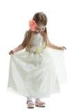 Nätt liten flicka i beige klänning Royaltyfria Bilder