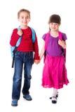 Nätt liten skolflicka och skolpojke Royaltyfria Foton