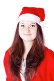 Nätt ung lady som kläs som Santa Claus Arkivfoto