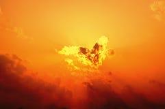 Nuage de coeur au coucher du soleil Photos libres de droits
