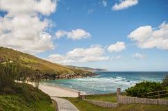 Nuages au-dessus de la plage Photo libre de droits