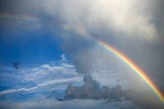 Nuages avec l'arc-en-ciel Photographie stock libre de droits