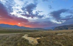 Nuages colorés par coucher du soleil Images libres de droits