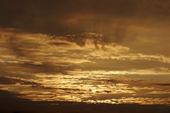 Nuages d'or Image stock