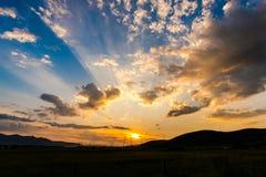 Nuages de coucher du soleil Images libres de droits
