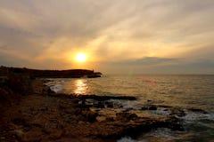Nuages de mer de coucher du soleil Photos libres de droits