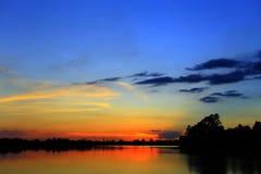 Nuages et coucher du soleil Photographie stock
