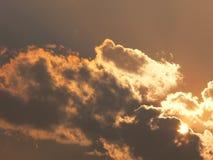 Nuages et soleil Photographie stock