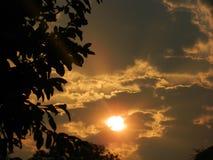 Nuages et soleil Images stock