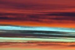 Nuages excessifs de coucher du soleil Image libre de droits
