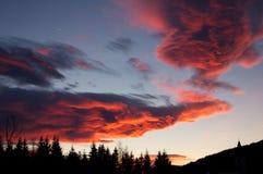 Nuages rouges dans les Alpes Photographie stock