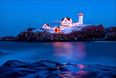 Nubble Lighthouse in Maine During Holiday Season. Cape Neddick (Nubble) Lighthouse in Maine is lit during the holiday season and in the Festival of Lights six Royalty Free Stock Image