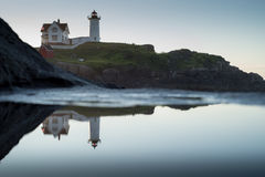 Nubble Lighthouse and reflection after dawn Stock Image
