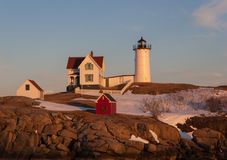 Nubble Lighthouse at sunset. This is the Nubble Lighthouse (also called Cape Neddick) at sunset in the winter Stock Photo