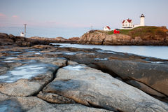 Nubble Lighthouse at sunset Stock Images