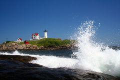 Nubble with wave. Nubble lighthouse with wave crashing nearby Stock Image