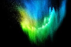 Nube azul de la explosión del polvo del verde amarillo aislada en fondo negro Foto de archivo libre de regalías