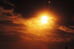 Nube con el sol Imagenes de archivo