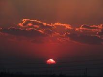 Nube con el sol Fotos de archivo