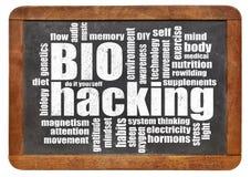 Nube de la palabra de Biohacking en la pizarra Imagen de archivo
