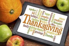 Nube de la palabra de la acción de gracias en la tableta Foto de archivo libre de regalías