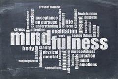 Nube de la palabra del Mindfulness en la pizarra fotos de archivo libres de regalías