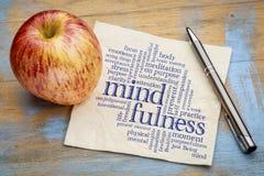 Nube de la palabra del Mindfulness en servilleta foto de archivo libre de regalías