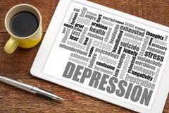 Nube de la palabra de la depresión en la tableta con café Imagen de archivo